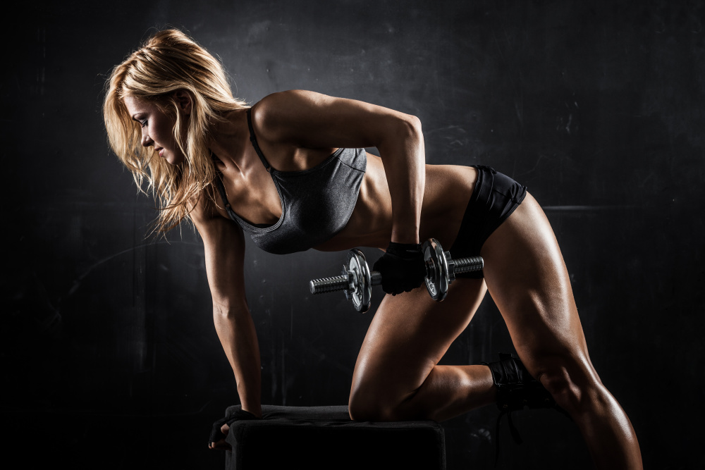 female in gym strength conditioning with Velvet Antler