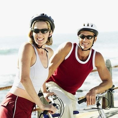couple smiling while on bicycles